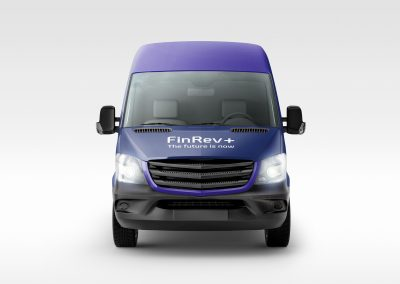 Front of large blue van with FinRev Plus branded wrap on the bonnet